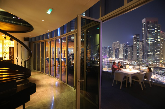 Atelier M at Pier 7 rooftop bar at night with marina views