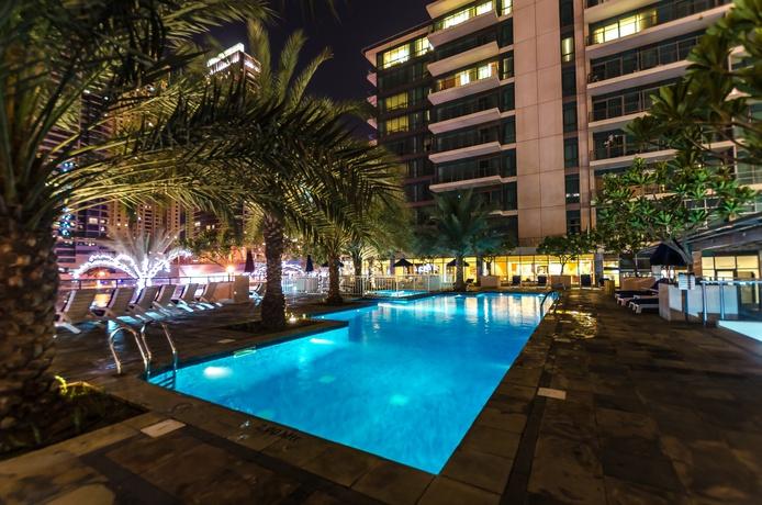 Nuran Marina outdoor swimming pool at night