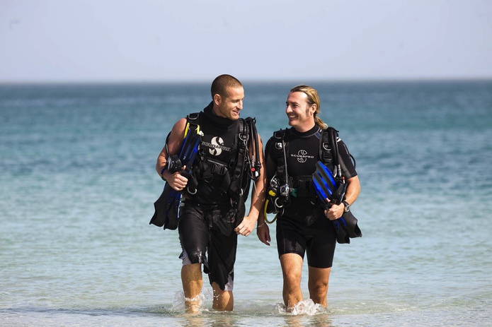 Divers walking out from the sea