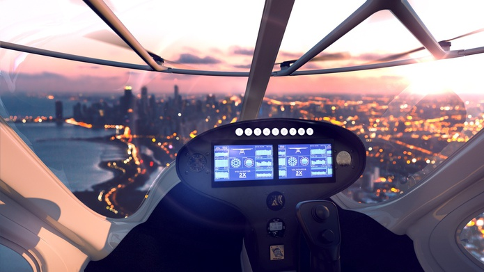 Volocopter cockpit while flying over a city in the night