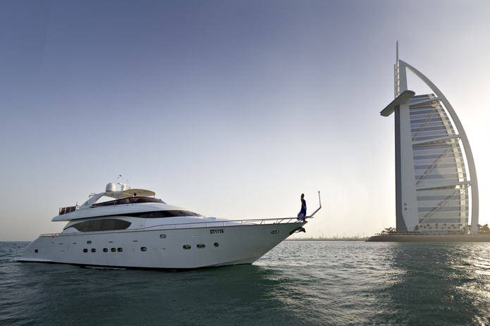 84 FT Yacht with the Burj al-Arab and a model in blue dress