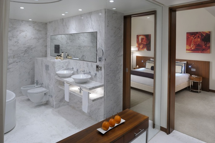 Media One Hotel chill out suite bathroom and bedroom
