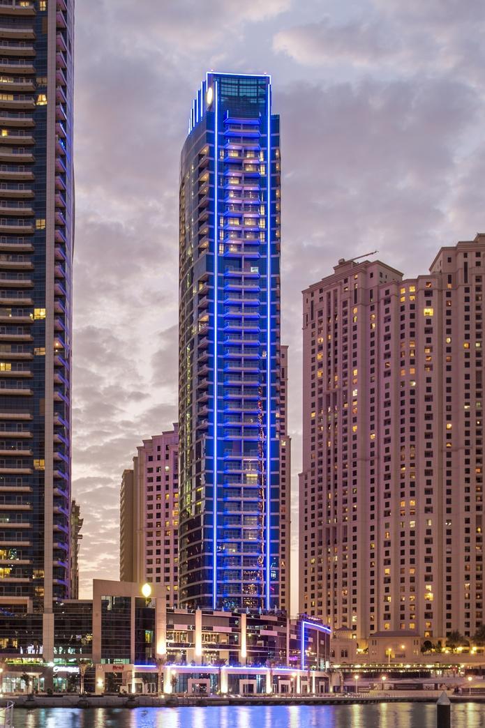 InterContinental Dubai Marina tower exterior at night