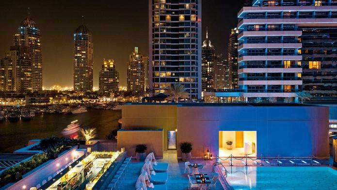 Siddharta Lounge by Buddha Bar at night with pool