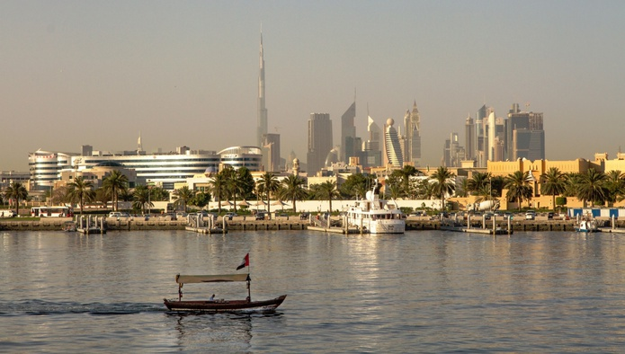 Abra water taxi and Dubai skyline in the background