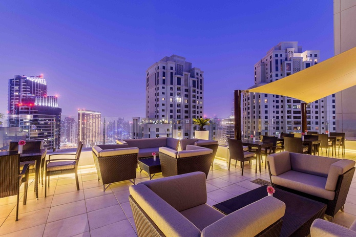 Hilton Dubai The Walk executive terrace with Dubai Marina panorama in the evening