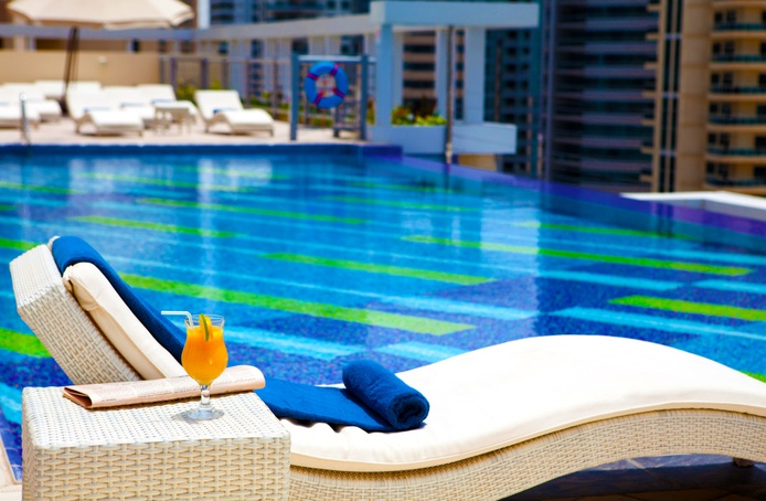 Marina Byblos Hotel Swimming Pool chilling with a cocktail
