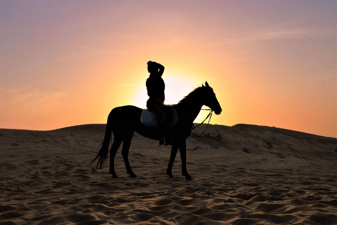 Horse riding in the Arabian Desert