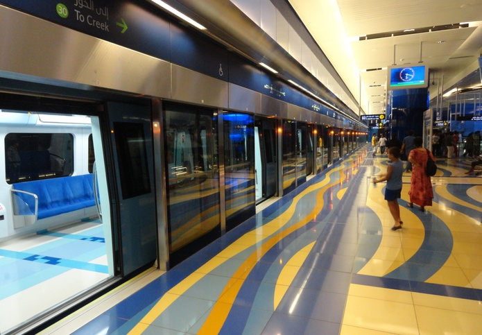 Dubai metro train with open doors at the station